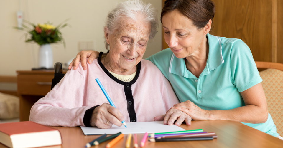 Lady drawing with live in carer